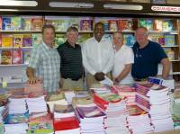 Daniel Cox, Ed Charbonneau, Henry Mawani, Fred Kurtz and Jim Heywood pose for a photo in the Text Book Store they visited to purchase text books for a Masai school in Kenya.