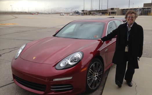 Here's my proof I want' dreaming. Delta chauffeur Deborah Pratt stands beside one of the most beautiful cars I've ever ridden in, a gorgeous Porsche.